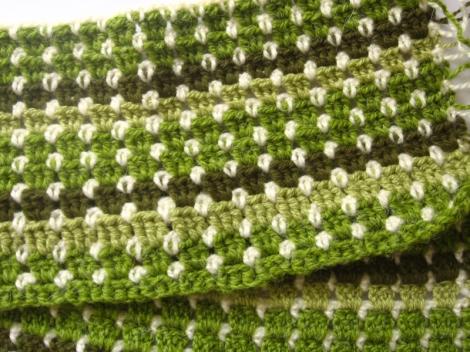 crocheted green afghan